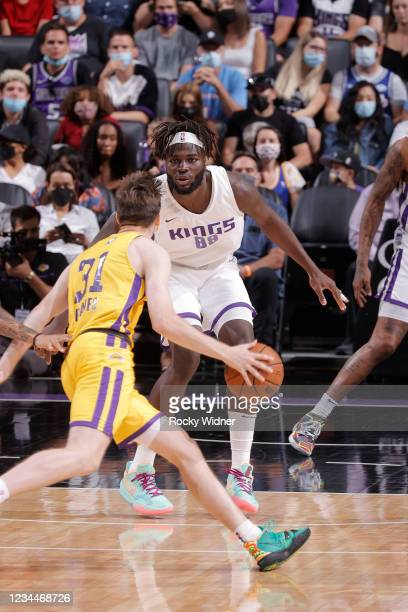 Neemias Queta of the Sacramento Kings plays defense on Austin Reaves of the Los Angeles Lakers during the 2021 California Classic Summer League on...