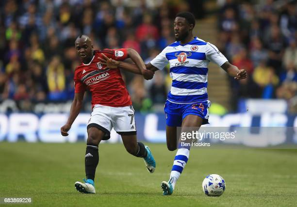Neeskens Kebano of Fulham and Tyler Blackett of Reading battle for possession during the Sky Bet Championship Play Off Second Leg match between...