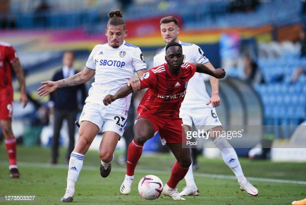 Neeskens Kebano of Fulham is challenged by Kalvin Phillips of Leeds United during the Premier League match between Leeds United and Fulham at Elland...