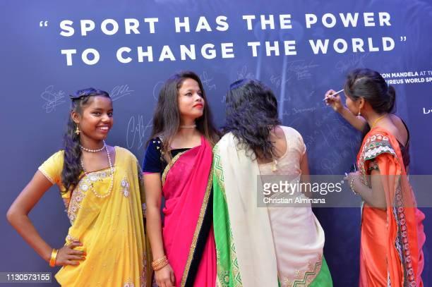 Neeta Kumari Hema Kumari Konika Kumari Radha Kumari of the Yuwa Football Girls team a footballbased charity from India sign the Nelson Mandela Wall...