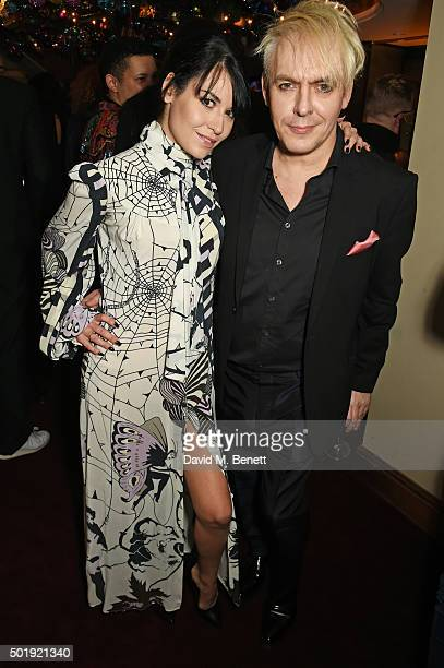 Nefer Suvio and Nick Rhodes attend the LOVE Christmas party at George on December 18 2015 in London England