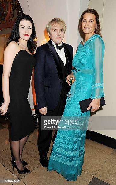 Nefer Suvio Nick Rhodes and Yasmin Le Bon wearing Star Diamond attend the Place For Peace dinner cohosted by Ella Krasner and Forest Whitaker to...