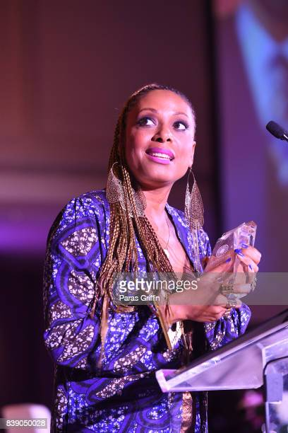Nefertite Nguvu speak onstage at 2017 BronzeLens Film Festival Women SuperStars Luncheon at Westin Peachtree Plaza on August 25 2017 in Atlanta...