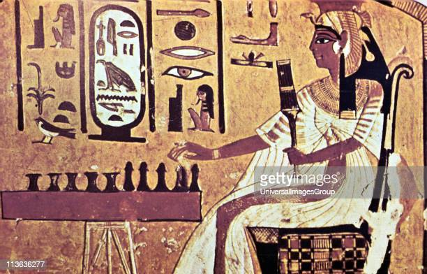 Nefetari favourite queen of Ramses II seated playing Senat the Egyptian board game which is forerunner of chess Her cartouche is highlighted in white...