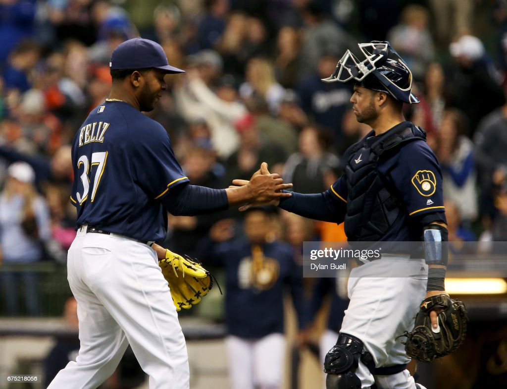 Neftali Feliz #37 and Manny Pina #9 of the Milwaukee Brewers celebrate after beating the Atlanta Braves 4-3 at Miller Park on April 30, 2017 in Milwaukee, Wisconsin.