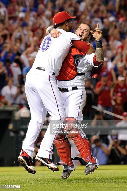 Neftali Feliz and Mike Napoli of the Texas Rangers celebrate winning Game Six of the American League Championship Series 155 against the Detroit...