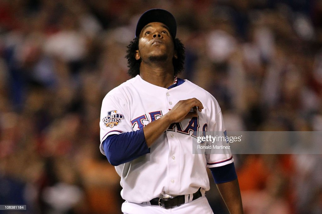 Neftali Feliz #30 of the Texas Rangers reacts after he recorded the final out of their 4-2 win against the San Francisco Giants in Game Three of the 2010 MLB World Series at Rangers Ballpark in Arlington on October 30, 2010 in Arlington, Texas.