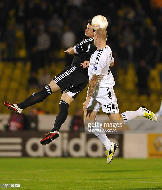 Neftchi's Nicolas Canales vies for the ball with Partizan's Milos Ostojic during the UEFA Europa League group H football match between Partizan...