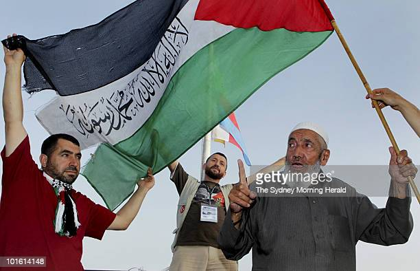 Negati Akar Recap Goker from Turkey and Ismail Ali wave the Palestinian flag onboard the Turkish passenger ship Mavi Marmara as it heads to Gaza as...