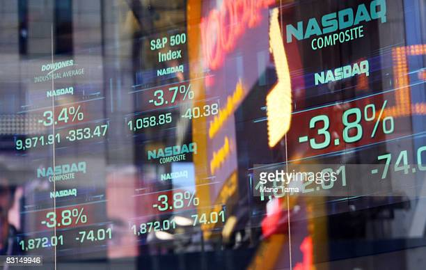 Negative numbers are seen on tickers at the Nasdaq MarketSite October 6 2008 in New York City The Dow Jones industrials dropped more than 800 points...