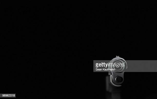 negative space   - gun barrel stock pictures, royalty-free photos & images