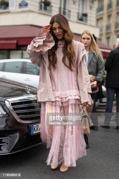 Negin Mirsalehi is seen on the street attending VALENTINO during Paris Fashion Week AW19 wearing VALENTINO pink dress and bag on March 03 2019 in...