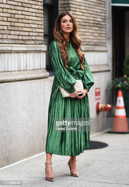 Negin Mirsalehi is seen wearing a green Marc Jacobs dress outside the Marc Jacobs show during New York Fashion Week S/S20 on September 11, 2019 in...
