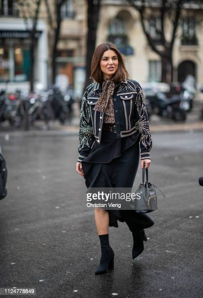 Negin Mirsalehi is seen wearing ruffled skirt jacket blouse outside Elie Saab during Paris Fashion Week Haute Couture Spring Summer 2019 on January...