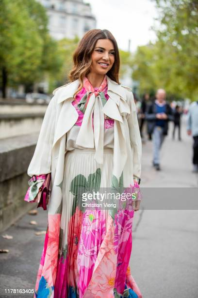 Negin Mirsalehi seen wearing pleated dress and coat with floral graphic print outside Valentino during Paris Fashion Week Womenswear Spring Summer...