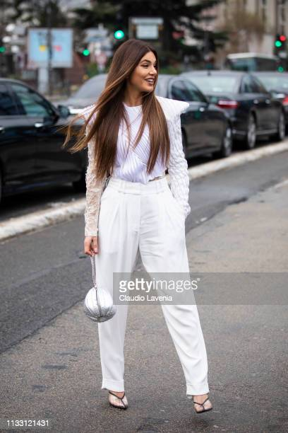 Negin Mirsalehi wearing a white top white pants seethrough shoes and silver bag is seen outside Balmain on Day 5 Paris Fashion Week Autumn/Winter...
