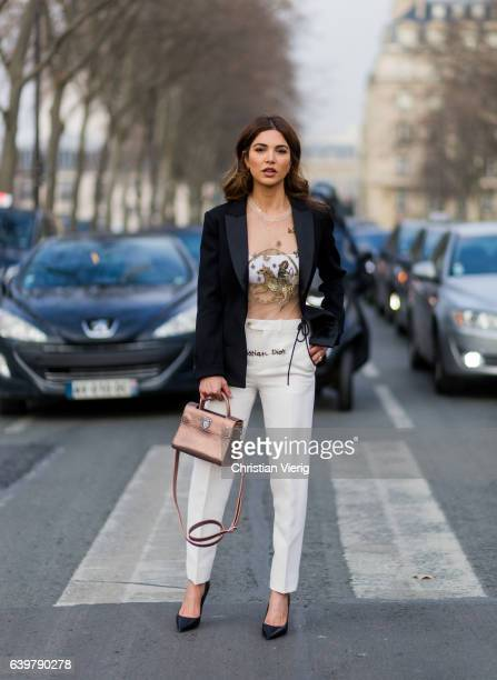 Negin Mirsalehi wearing Dior blazer white pants heels and bag outside Dior on January 23 2017 in Paris Canada