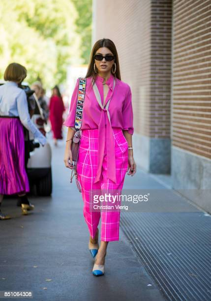 Negin Mirsalehi wearing pink blouse pink checked cropped pants is seen outside Fendi during Milan Fashion Week Spring/Summer 2018 on September 21...