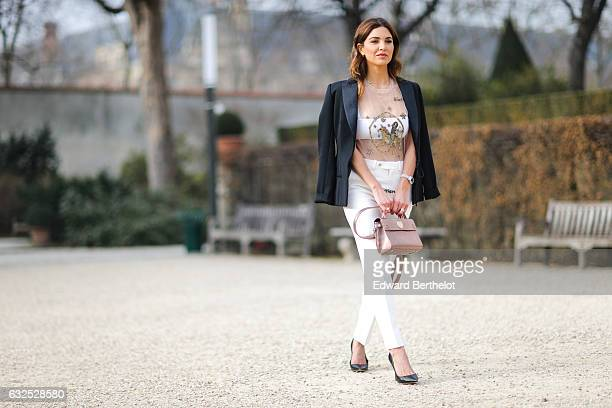 Negin Mirsalehi wears a black blazer jacket white pants a Dior bag black heels and attends the Christian Dior Haute Couture Spring Summer 2017 show...