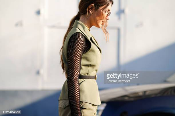 Negin Mirsalehi wears fishnet sleeves and a green jacket outside Dior during Paris Fashion Week Haute Couture Spring Summer 2020 on January 21 2019...