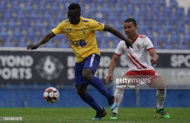 Nego Tembeng of GD Estoril Praia with Gustavo Tocantins of UD Vilafranquense in action during the Liga Pro match between GD Estoril Praia and UD...