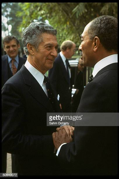 US negotiator Sol Linowitz shaking hands w Egyptian Pres Anwar Sadat at Barrages