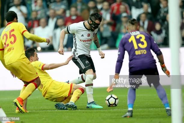 Negredo of Besiktas in action against Castro of Goztepe during the Turkish Super Lig soccer match between Besiktas and Goztepe at Vodafone Park in...