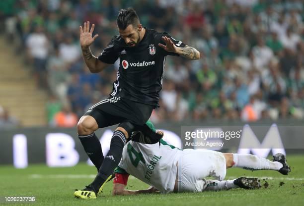 Negredo of Besiktas in action against Ertugrul Ersoy of Bursaspor during the Turkish Super Lig match between Bursaspor and Besiktas at the Bursa...