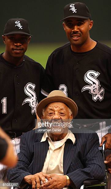 Negro League player Ted Double Duty Radcliffe celebrates his 102nd birthday with Willie Harris and coach Harold Baines of the Chicago White Sox...