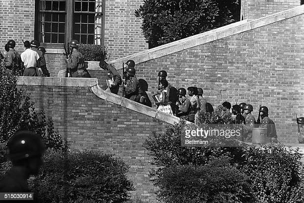 Negro students who had previously been barred from Little Rock Central High School were provided with portaltoportal protection in entering the...