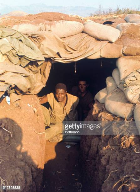 A negro US Marine peers out from his sandbagged bunker at this besieged allied stronghold