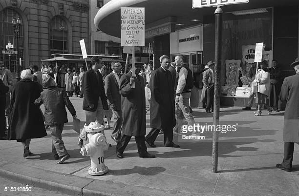 Negroes and whites joined here 2/27 in a sympathy protest here as they picket local Woolworth store on market St to bring to the attention of public...