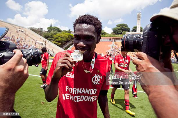 Negueba do Flamengo displays his gold medal after the soccer match Flamengo v Bahia as part of the Sao Paulo Juniors Cup 2011 at Pacaembu Stadium on...