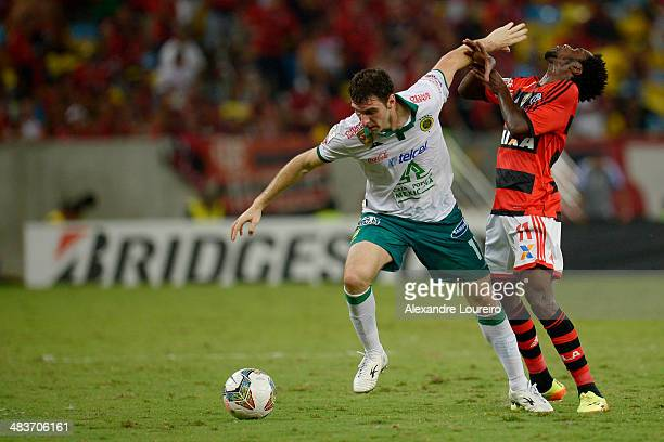 Negueba of Flamengo fights for the ball with Mauro Boselli of Leon during a match between Flamengo and Leon as part of Copa Bridgestone Libertadores...