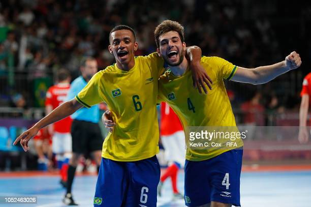 Neguinho and Breno of Brazil celebrate their 41 win over Russia in the Men's Futsal Final match between Brazil and Russia during the Buenos Aires...