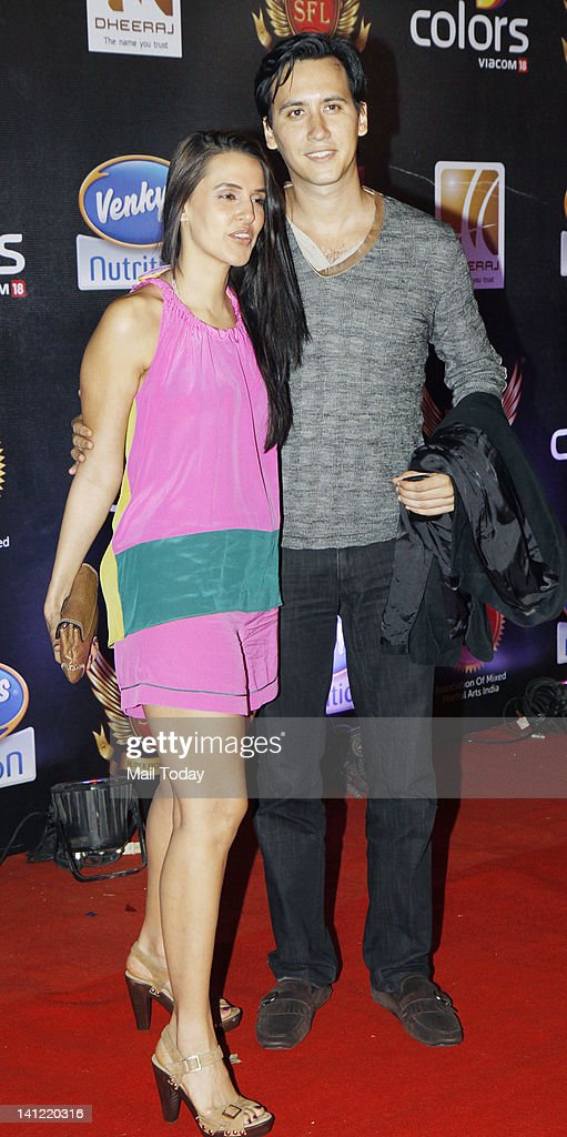 Neha Dhupia and her boyfriend Jimmy Sylvester pose during the inaugural of Super Fight League in Mumbai on March 11 2012 SFL is a mixed martial arts..