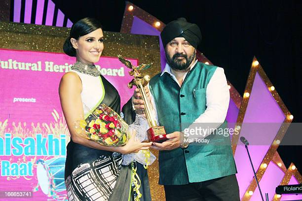 Neha Dhupia gives an award during the Baisakhi celebration in Mumbai on Friday night