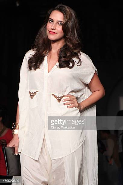 Neha Dhupia poses for pictures at day 5 of Lakme Fashion Week Summer/Resort 2014 at the Grand Hyatt on March 15 2014 in Mumbai India