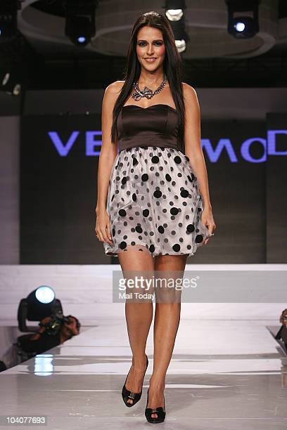 Neha Dhupia walks the ramp at the launch of three European apparel brands Only Vera Moda and Jack Jones in New Delhi on September 11 2010