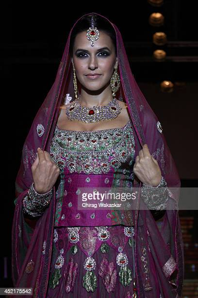 Neha Dhupia walks the runway at Gitanjali Gems show during day 1 of the India International Jewellery Week 2014 at grand Hyatt on July 14 2014 in...