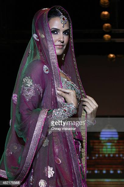 Neha Dhupia walks the runway at Gitanjali Gems show during day 1 of the India International Jewellery Week 2014 at grand Hyatt on July 14, 2014 in...