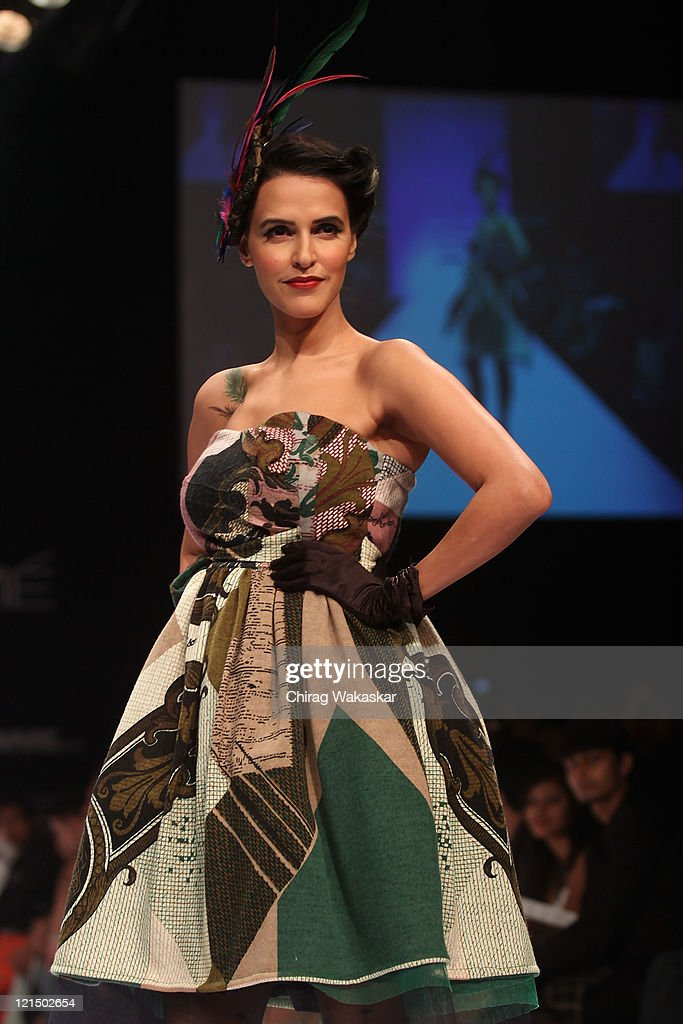 Neha Dhupia walks the runway at the Pam Arch show at Lakme Fashion Week Winter/Festive 2011 Day 4 at the Grand Hyatt on August 20 2011 in Mumbai India