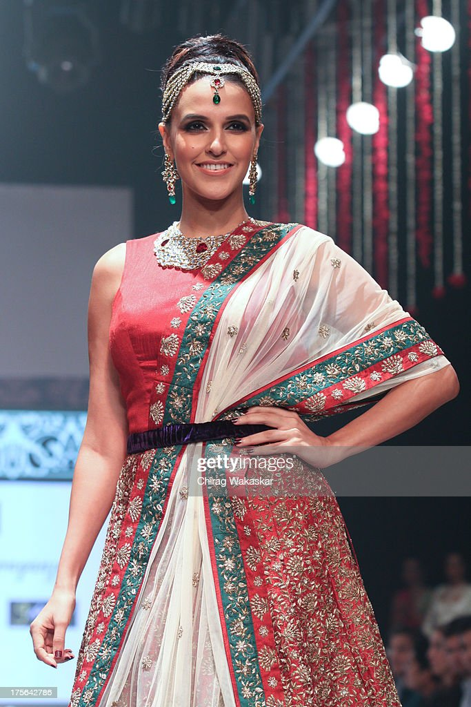 Neha Dhupia walks the runway in an Gitanjali design on day 2 of India International Jewellery Week 2013 at the Hotel Grand Hyatt on August 5 2013 in..