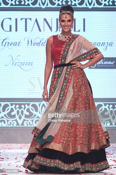 Neha Dhupia walks the runway in an Gitanjali design on day 2 of India International Jewellery Week 2013 at the Hotel Grand Hyatt on August 5 2013 in...