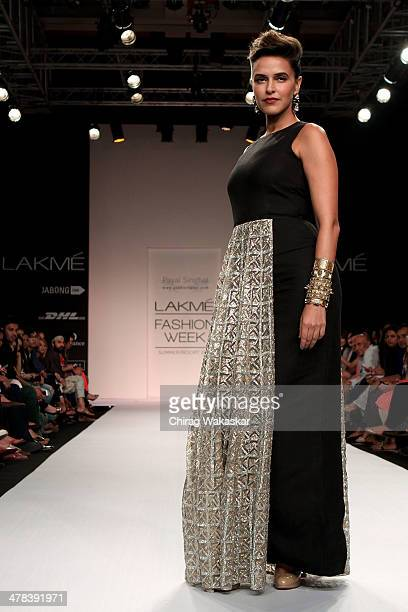 Neha Dhupia walks the runway wearing designs by Payal Singhal at day 3 of Lakme Fashion Week Summer/Resort 2014 at the Grand Hyatt on March 13, 2014...