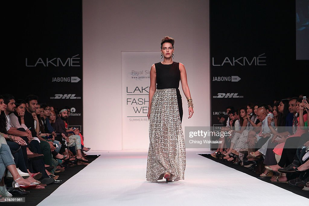Neha Dhupia walks the runway wearing designs by Payal Singhal at day 3 of Lakme Fashion Week Summer/Resort 2014 at the Grand Hyatt on March 13 2014...