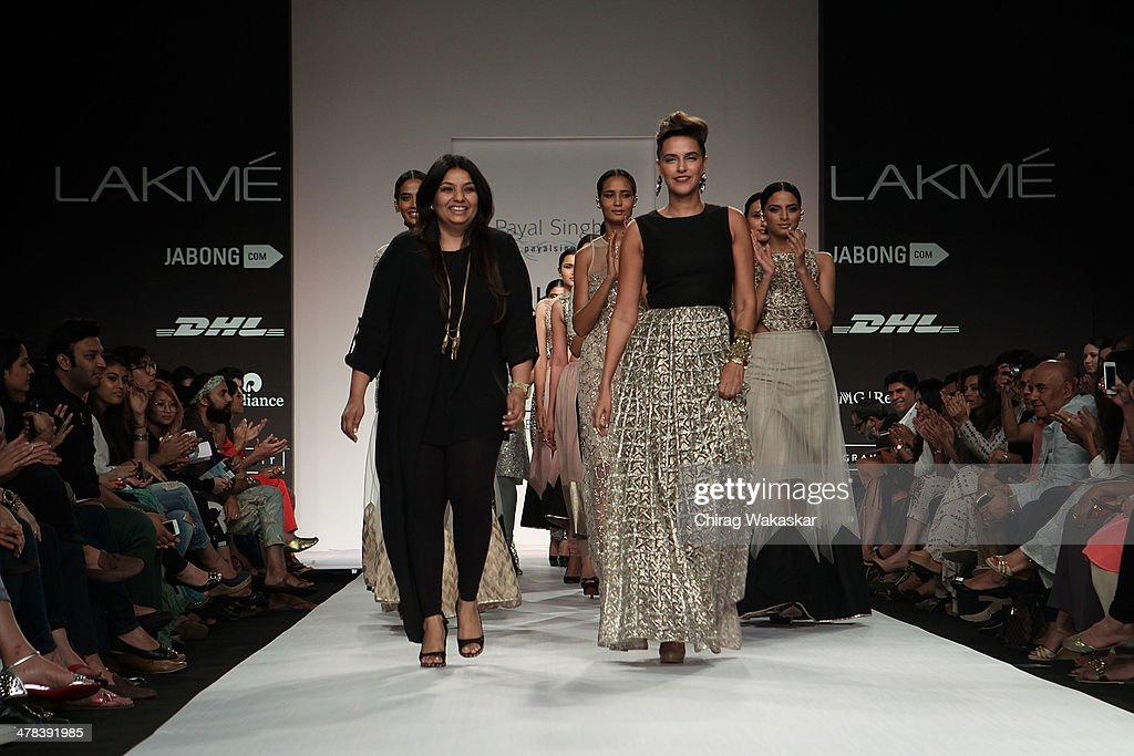 Neha Dhupia walks the runway with Payal Singhal during day 3 of Lakme Fashion Week Summer/Resort 2014 at the Grand Hyatt on March 13 2014 in Mumbai...
