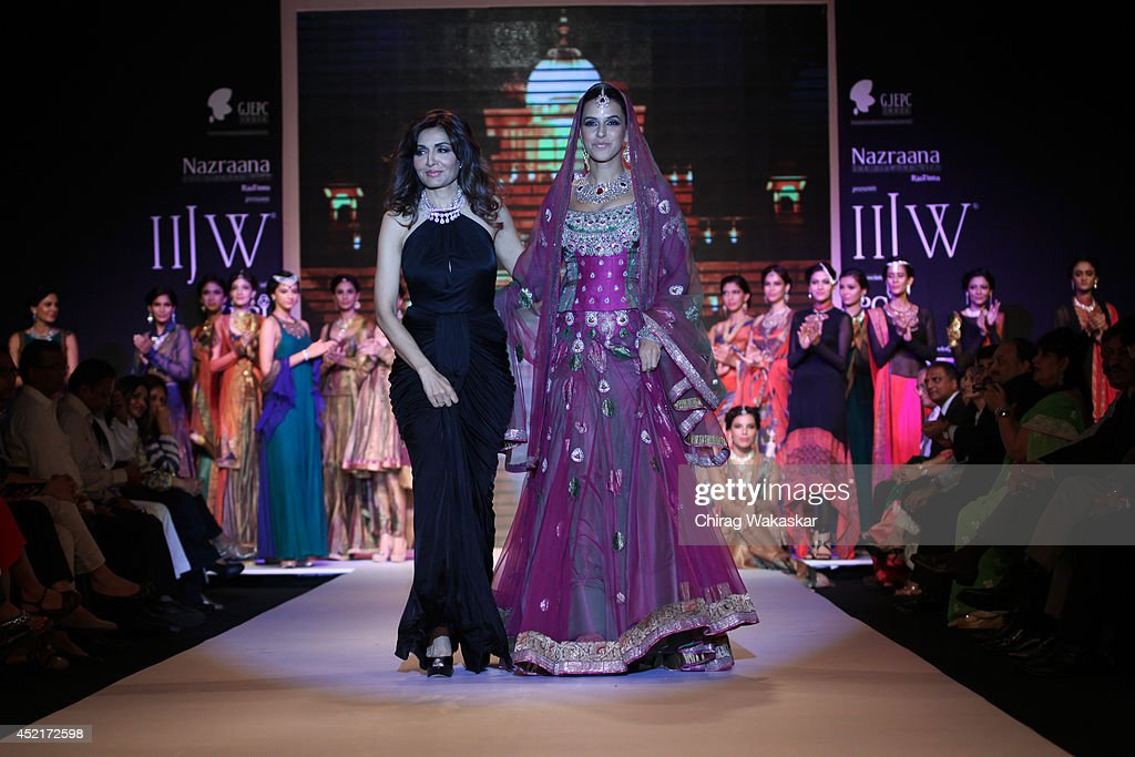 Neha Dhupia walks the runway with Queenie Singh at Gitanjali Gems show during day 1 of the India International Jewellery Week 2014 at grand Hyatt on..
