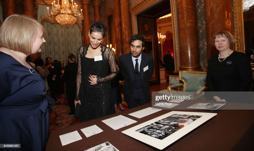 Neha Kapur and Kunal Nayyar look at a display from the Royal Collection during a reception to mark the launch of the UK-India Year of Culture 2017 on February 27, 2017 in London, England.