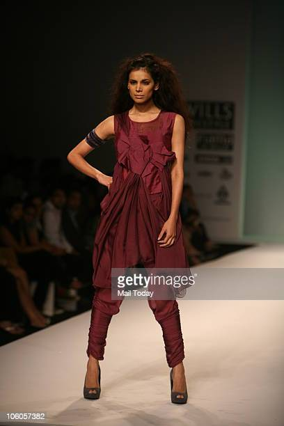 Neha Kapur walks the ramp for designer Roma Narsinghani on the third day of the Wills Lifestyle India Fashion Week in New Delhi on October 25 2010